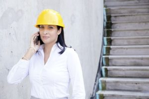 A woman in a helmet speaking on the phone