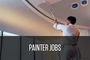 A painter painting the ceiling