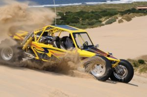 Dune Buggy Yellow Throwing Sand in Turn Winchester Bay Oregon cm