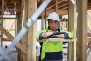 Construction-worker-leaning-on-wooden-plank
