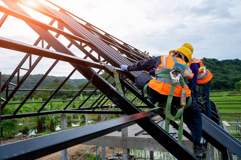 Roofer worker in protective uniform wear and gloves-cm